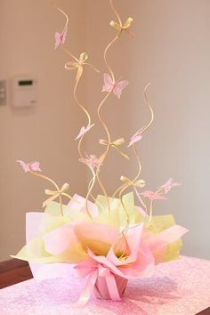 I love this butterfly centerpiece. I think it would be easy to make.