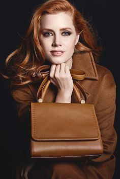 A visual from Max Mara's fall 2014 ad campaign featuring Amy Adams. [Photo by Mario Sorrenti]