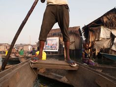 In Makoko—a slum neighborhood in Lagos, Nigeria partially built on the water—local teenagers photographed their surroundings, and large-scale prints of their work were displayed in public spaces.
