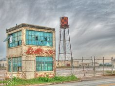 Saginaw Texas US Army Aircraft Plant Checkerboard Water Tower Broken Teal Glass Windows Chain Link Fence Cloud Shear