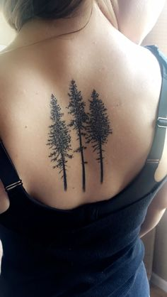 My newest tattoo- pine trees on the spine