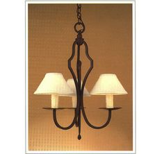 """7098  THREE LIGHT IRON CHANDELIER FINISH SHOWN: NATURAL RUST SHADE: 3X8X4 WITH WHITE WAX CANDLES MAXIMUM WATTAGE: 180 CANDELABRA BASE SOCKETS  HT 27"""" W 22"""""""
