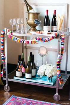 For your next fiesta, look no further for your decoration inspiration than this Stylish Bar Cart. With colorful fringe detail, this party essential is sure to liven up your home or apartment.