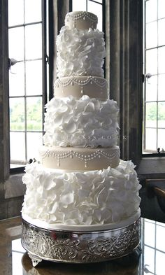 Something like this, but just the two middle layers. Beautiful Cake Pictures: Pretty White Ruffles & Pearls Wedding Cake : Cakes with Pearls, Cakes With Ruffles, Wedding Cakes Beautiful Wedding Cakes, Gorgeous Cakes, Pretty Cakes, Dream Wedding, Wedding Day, Elegant Wedding, Purple Wedding, Yacht Wedding, Gold Wedding