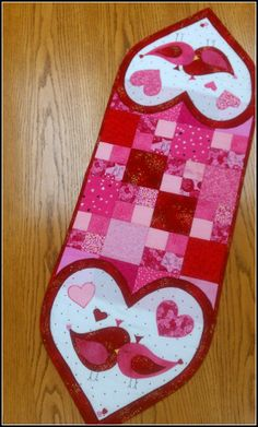 This is a reader version of my Love Birds table runner from Quick Quilts 2014...love the tiny hearts she added to their little tails! -Kathy-