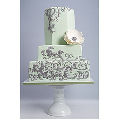 This mint green frosted cake only with gold filigree and violets