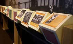 Spinning boxes with exhibition information on each side. Easy and cheap interactive display.