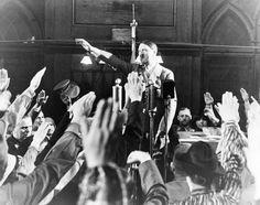 In the Schwemme in Munich, 1938. Schaub on the left, Lutze by Hitler's elbow