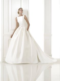 K Brides: Pronovias. Low-waisted princess style dress in mikado silk. Bateau neckline with edging. Bow at the waist with a belt effect. Wedding Dresses Photos, Fall Wedding Dresses, Wedding Dress Styles, Wedding Suits, Bridal Dresses, Wedding Gowns, Bateau Wedding Dress, Pronovias Wedding Dress, Wedding Dress Necklines