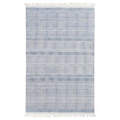 Surya's Idina printed cotton rug boasts a brilliant geometric pattern and traditional fringe details. Perfect for any bedroom or living room, this graphically appealing accent features a stunning duo-tone colorway. A gradated design forms a floor covering with unmatched visual texture. Sizes: 2ft W x 3ft H, 2ft-6in W x 8ft H, 4ft W x 6ft H, 5ft W x 7ft-6in H, 8ft W x 10ft H; Colors: Blue and Gray; Material: 100% cotton; Pile: none; Care Instructions: professional cleaning recommended.