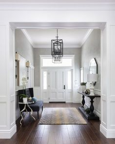 entrance, foyer, timber floors, black lanterns, wainscoting