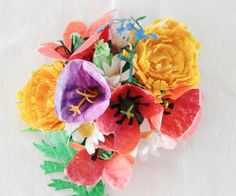 Paper wax bouquet | 10 Ways To DIY Gorgeous Flowers For May Day.