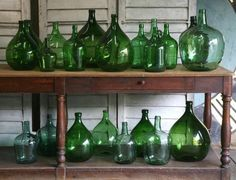 Lovely collection of Vintage Demijohns! Do the same with ours! #LaBoutiqueVintage www.laboutiquevintage.co.uk