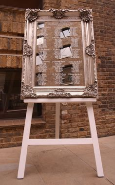 Large silver mirror (also available in gold) and easel used here as a table plan at Devonshire Terrace by www.stressfreehire.com #venuetransformers