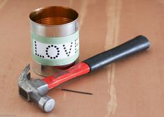 Learn how to make an easy upcycled tin lantern from a tin can! These DIY tin can lanterns are perfect for a rustic wedding or Valentine's Day. Diy Coat Rack, Coat Hanger, Easy Valentine Crafts, Valentines, Tin Can Lanterns, Hanger Crafts, Tin Can Crafts, Space Party, Upcycled Crafts
