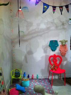 bunting, hanging pom-poms, gauzy light covers and neon pops of color!!
