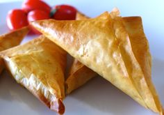 Greek Feta Cheese Triangles Recipe (Tiropitakia) www.recipes with feta;spinach and feta; Greek Cheese Pie, Cheese Pies, Cheese Snacks, Savory Snacks, Cheese Sauce, Pastry Recipes, Cooking Recipes, Freezer Recipes, Greek Meze