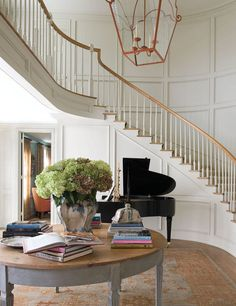 Image via Carol Glasser Interior Design This foyer could have taken on many different looks with the sweeping curved staircase and the paneled walls. The predictable would have been to go formal, but the sisal Foyer Staircase, Entryway Stairs, Curved Staircase, Entry Hallway, Staircase Design, Entryway Decor, Winding Staircase, Spiral Staircases, Foyer Decorating