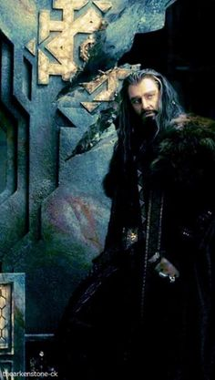 THORIN with the throne, damaged when Smaug took the Arkenstone from it.