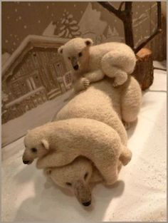 Needlefelted polar bear family