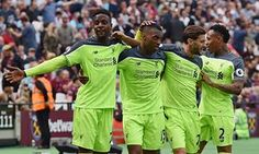 Origi celebrates after scoring the fourth goal for Liverpool.