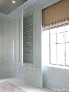 hidden storage behind paneling