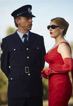 "Sergeant Horatio Farrat and Myrtle ""Tilly"" Dunnage - Hugo Weaving and Kate Winslet in The Dressmaker, set in the 1950s (2015)."