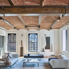 Contemporary furnished industrial loft with brick barrel vaulted ceiling. Loft Industrial, Industrial Apartment, Industrial Design, Industrial Decorating, Industrial Furniture, Architecture Details, Interior Architecture, Brick Archway, Barrel Vault Ceiling