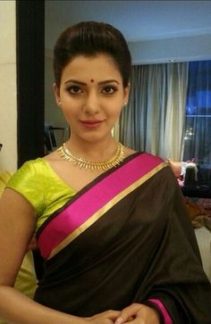 Samantha Prabhu in a simple black and pink silk saree and blouse. Celebrity fashion.