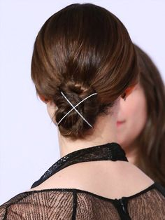 Emmy Rossum's bun hairstyle with diamond cuff - click through for more party and wedding celebrity updo ideas