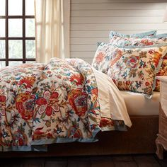 summer flower duvet cover set provides a refreshing floral print in burnt orange, light turquoise, and other warm tones on soft cotton voile