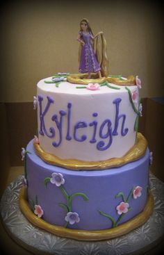 """Tangled - A customer brought in a picture of this cake for me to """"copy"""".  I see they found it here on CC.  Thanks to """"wondermomx4"""" for her idea!   This is a 6/8 buttercream cake.  Hair is just rolled out fondant wrapped around each layer, painted with luster dust."""