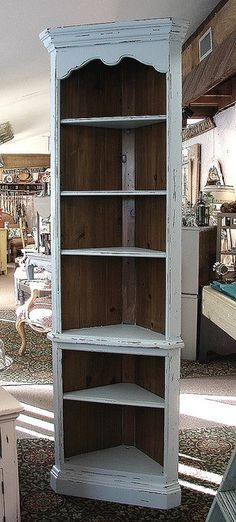 I want this type of shelf for my cookbooks. Vintage Ethan Allen Distressed Pale Gray Painted Corner China Cabinet Bookcase Cupboard. $325.00, via Etsy.