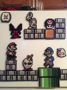Halloween themed Super Mario plastic canvas fridge magnets I've been working on.