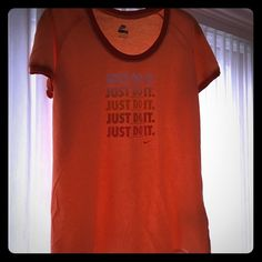 "Nike ""Just Do It"" Tee-shirt XL NWOT Nike tee with ""Just Do It"" logo in raised lettering. This delicious orange sorbet color looks great in and out of the gym.  Brand new with Nike tag sown into the bottom of shirt. Bundle to save more!! Nike Tops Tees - Short Sleeve"