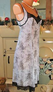 VTG BLACK WHITE FLORAL SLIPPY SOFT NYLON FULL SLIP NIGHTIE GOWN DRESS R11479 For more pictures of the same please visit any of my blogs: Tumblr  link   http://sangriasuzie.tumblr.com/ Wordpress blog link  http://sangriasuzie.org/ http://stores.ebay.co.uk/Sangriasuzies-Emporium http://www.sangriasuzie.com/ If any of the  items pictured in this blog/pin take your fancy they can be bought from one of the above addresses.  Or e-mail me at drobertshq@hotmail.com   if you need more info.