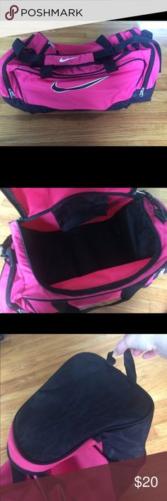 Nike gym bag Pink and black Nike gym bag. Has three compartments (one big center and two side compartments). Has hand straps and long padded shoulder strap. Also has material handle on on end to hang by. Great condition. Nike Bags Totes