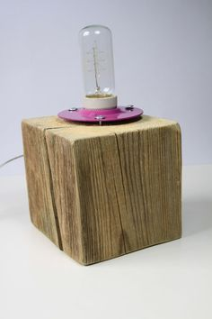 This original handmade lamp will be a perfect complement in any interior.  The base of the lamp is made of natural, old wood, polished by natural
