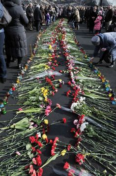 Flowers and candles leading to the barricades in Kyiv, Ukraine. 24-2-2014