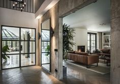 The hall and living room in wood, black steel doors and windows - theartofliving. Chalet Design, House Design, Steel Doors And Windows, Hall And Living Room, Luxury Interior, Interior Design, Future House, Sweet Home, New Homes