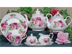 A lovely pattern of pink and red roses, our Summertime Rose collection of fine bone china is made and imported from England. Find beautiful tea sets at English Tea Store, including complete fine bone china sets on sale! English Tea Store, China Tea Sets, Bone China Tea Cups, Tea Pot Set, Rose Tea, Antique Roses, China Patterns, Tea Party, Tea Time