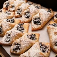 Kieflies - traditional Hungarian cookies made from a rich sour cream dough and filled with jam or nuts.