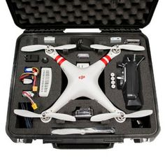 Go Professional Cases DJI Phantom Case for Quadcopter and GoPro Cameras Water-jet precision cut case with no die-cutting or punch-cutting Custom foam interior is housed in an SKB military spec case Meets ATA carry-on requirements so it's ea Drones, Drone Quadcopter, Dji Phantom 1, Gopro Hero 3, Gopro Camera, Gopro Hd, Camera Case, Drone Technology, Technology Gadgets