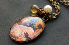 Summer Necklace. Alphonse Mucha Pendant with Amber Teardrop and Fresh Water Pearl. Oval Charm Necklace. Sunflower Jewelry. Handmade Jewelry. by StumblingOnSainthood from Stumbling On Sainthood. Find it now at http://ift.tt/2t1L1cD!