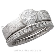 Mokume Solitaire Engagement Ring with Diamond Channel Brilliant Eternity Wedding Band - A little more modern than the tapered style engagement ring, this ring has a completely straight band without the tapering toward the setting. The standard width for the band is 4 mm, but choose your width to make it your unique engagement ring.   - This designer engagement ring has a round diamond in its setting and a band of White mokume gane. It is shown with a Brilliant Eternity Diamond Channel…