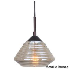 Expose your decor setting with this brilliant Queen Style Mini Pendant from Woodbridge Lighting. This single light fixture features the options of a metallic bronze or satin nickel finish with plated gold glass shade resembling a beehive.