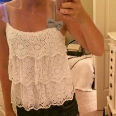 White lace hollister top In perfect condition. Super cute and fun to wear!! Hollister Tops Blouses