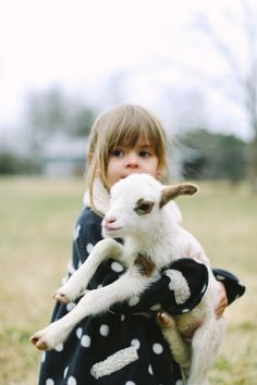 baby goat and girl