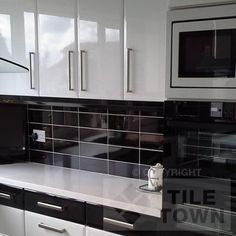 Black Kitchen Tile kitchen backsplash: funky effect using basic, inexpensive tiles. a