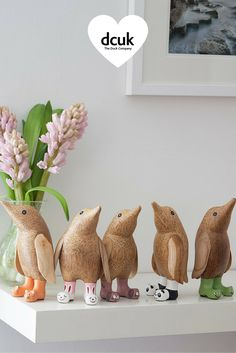 The Duck Company hand carved wood penguins with animal welly boots. Gorgeous gifts for penguin fans - lovely natural home accessories, from DCUK